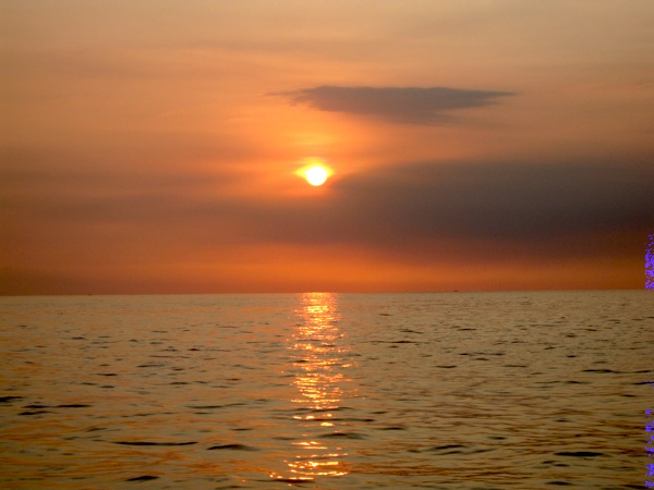 sunset from perama boat