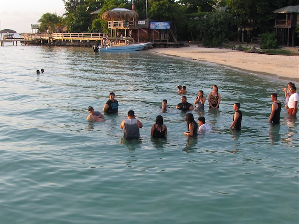 Getting baptized in the ocean - West Bay, Roatan, Honduras
